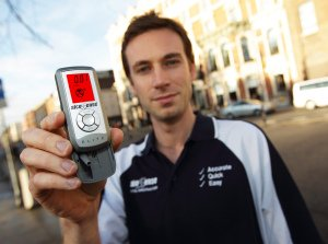 Man holding breathalyser, Alco Sence PR photography.