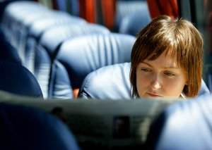 Woman reading newspaper on Aircoach, professional PR photo.