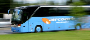 Aircoach travelling at speed, marketing photo.