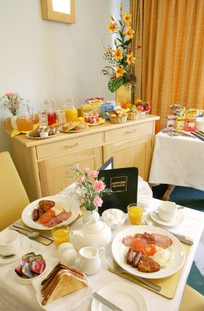 Interior Photo of breakfast table at Airport Manor Hotel.