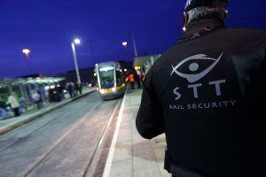 Luas platform at night, security team at work.