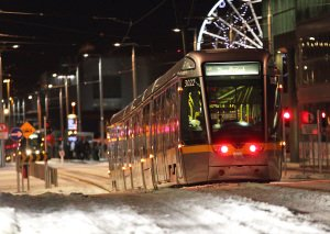 Luas Tram at Night in Snow, professional photograph.